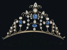 A diamond and sapphire diadem,  white gold 750, old-cut diamonds, some of tear cut and oval cut, total weight ca. 7 ct, sapphires, total weight ca. 8 ct, workmanship 1st third 20th cent., 49,8 g