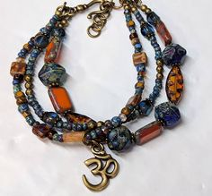 Hey, I found this really awesome Etsy listing at https://www.etsy.com/listing/551358165/earthy-boho-chic-bracelet-colorful-glass
