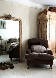 Cottage Chic Bedroom...love Armoire,chair,Vintage Mirror & reflection of the bed in the mirror.