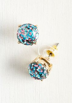 It's about all you can 'luster' to not grin from ear to ear when you're sporting these sparkling studs! Made to catch the eye with royal blue, pink, and seafoam glitter and gold frames, these earrings are definitely something to be giddy about.