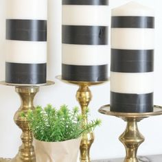Washi tape and cheap white candles make and easy project - black and white striped candles