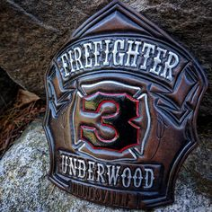 Huntsville Alabama FD.  Espresso finish with painted details on Herman Oak leather.  TryWorks Leather Co.  Bespoke Fire Helmet Shields of the highest quality.  Handcrafted in Maine.  http://ift.tt/2910W2a.  Visit our website or contact TryWorksLeather@gmail.com for order inquiries.  Prices $195 - $265.  #fireshield #firefront  #firefighterowned #handcrafted #firehelmet #customleather #goldleaf #handpainted