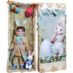 """Lovely 4 1/2"""" All Bisque Antique (glass eyes) Mignonette Easter Bunny doll in box of Easter accessories"""