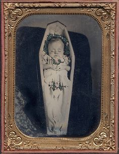 This haunting cased Ambrotype is unflinching in its acceptance of the the baby's death. No attempt has been made to suggest the infant is only asleep.