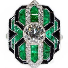 An Art Deco platinum, emerald, onyx and diamond ring, circa 1925. #artdecojewelry #emerald #impressiverings #artdecoring #attractivering#geometricalart #geometricaljewelry