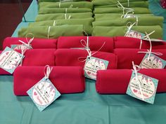 Great idea for ice skating party! Colorful winter scarves as favors! Personalized favor tags thank guests! For party details visit www.thatpartychick.net