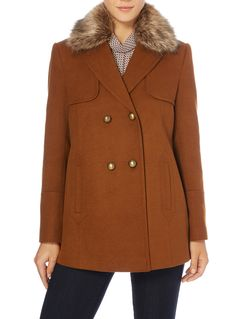 Add some retro-inspired vibes to your winter looks with this tan coat, which…