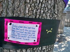 Signs protesting the cutting down of trees on  Main Street in Yellow Springs Ohio