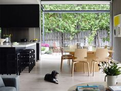 Small Spacious House Design by Foong + Sormann Architects elegant interior design kitchen entirely black veneer
