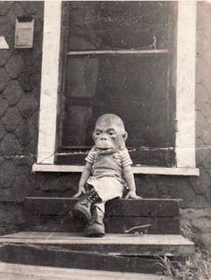 Vintage Black and White Photo Child on Halloween wearing an ape mask.