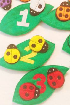 """F elt lady bug counting and color matching game. Game has a total of 27 pieces. Leaves measure about 6"""" X 3"""" and lady bugs measure about 2"""" X 1 1/2"""" Children match the black spots on the lady bugs with the corresponding number on the leaves as well as matching the lady bug colors with the colored number on the leaves. Great for counting and color practice. Game includes: 6 Green leaves with numbers 1-6 in different colors 1 - #1 white lady bug 2- #2 yellow lady bugs 3- #3 red lady bugs 4…"""