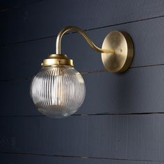 This Holophane Glass Globe Brass Wall Sconce fixture features Raw Brass Outdoor Wall Lighting, Living Room Lighting, Wall Sconce Lighting, Kitchen Wall Lighting, Modern Lighting, Nate Berkus, Glass Wall Lights, Brass Sconce, Beach Wall Decor