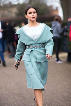 Miroslava Duma style. Miroslava Duma at LFW Fall 2014. Belted coat with bejeweled belt.