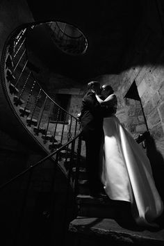 Black and White Photo Bride and Groom Inside Castle Created a Heart Shape With Lighting