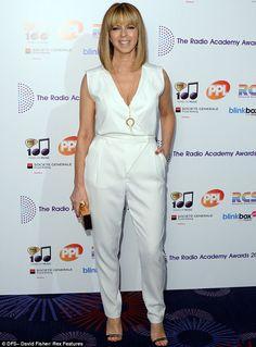 Shine bright: TV presenter Kate Garraway showed off her trim figure in a white jumpsuit...