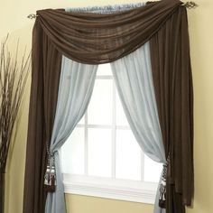 Thinking of hanging a different style with my sheer drapes ready in the living room.