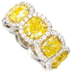 Magnificent Fancy Yellow diamond eternity band, features Carats of Fancy Yellow Cushion Cut Diamonds, surrounded by Carats of white round brilliant cut diamonds. Each stone is approximately carats, cushion cut. Eternity Ring Diamond, Eternity Bands, Wedding Rings Vintage, Vintage Rings, Vintage Jewelry, Canary Diamond, Canary Yellow Diamonds, Colored Diamonds, Jaune Orange