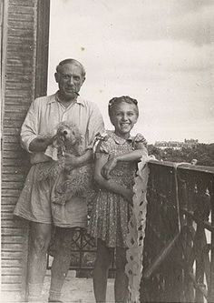 Pablo Picasso with his daughter Maya and their poodle.