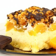 A Very tasty recipe for chocolate and crumble topped peach cheesecake bars.. Peach Cheesecake Bars Recipe from Grandmothers Kitchen.