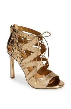 Love! This metallic gold cage sandal will look hot with a cute LBD.