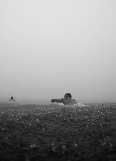 """Mick Fanning - rainy day paddle out. Photo Andrew """"Shorty"""" Buckley"""
