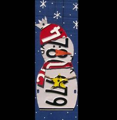 so cute! snowman is made of recycled license plates.