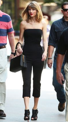 JULY 11, 2014 The singer looked impeccable in a sultry Reformation jumpsuit for an outing in New York City. She completed her all-black ensemble with a Dolce & Gabbana handbag, Christian Louboutin sandals, and a cherry red lip.