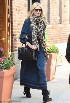 On the fringe: Claudia embraced the autumn season in a maxi long-sleeve blue dress, that a...