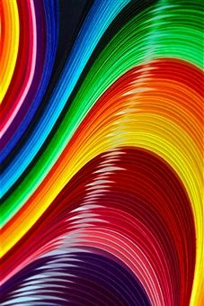 Curves of colored paper Photographer: Image by Catherine MacBride
