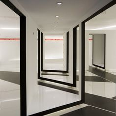 Song Max store by Elevation Workshop in Beijing, L-shaped lifted stage creates closet, catwalk, stage.
