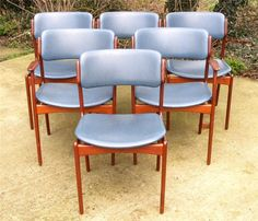"""This is a wonderful set of 6 Danish teak dining chairs by designer Eric Buck dating to 1960's  Set consists of four dining chairs and two carver / arm chairs  These chairs are constructed of high quality teak and are quickly becoming a classic. The chairs have floating seats covered in blue vinyl  Comfort is provided by a deep curve in the backrest.  Label to seats """"Made in Denmark Oddense Maskinsnedkeri A-S""""  www.antiques-online.org"""