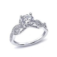 This captivating engagement ring features a twisted shank of pave set diamonds which wraps around the finger. Built to hold a 1CT center stone. (LC6016) #engagement #wedding #proposal