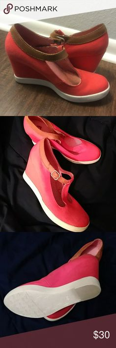 Cute sneaker (like) wedges!! Red & white wedge, with a T strap/buckle. Adorable & worn TWICE. I've recently found out I have Fibromyalgia, so shoes like these cause pain in my knees. I hate to let them go, but Im hoping to find a good home for them here!! BC Footwear Shoes Wedges