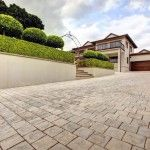 We have an extensive range of textured concrete cobbles to add a beautiful finish to your driveway. Browse our driveway paving ideas. Paving Ideas, Driveway Paving, Concrete, Sidewalk, Garage, Patio, Mood, Outdoor Decor, Beautiful