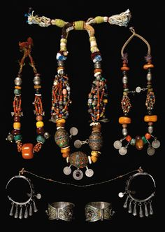 Morocco | 3 necklaces from the Anti Atlas region, a pair of silver and enamel earrings (Ida ou Semlal, Tiznit) earrings and a pair of silver and enamel 'Khalkhal' anklets (first quarter 20th century)
