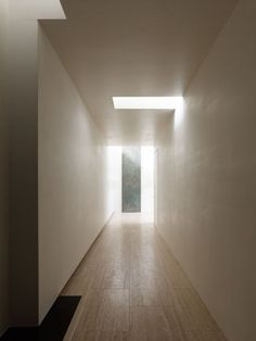 Daylight entering a corridor adding drama inside the N-House by Takato Tamagami.
