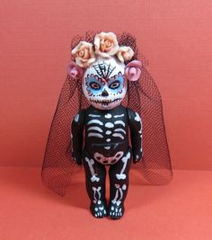 Day of the Dead Baby Doll. Formerly a Renwal baby boy.