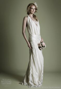 This is more of a beach-y type wedding dress but I am loving that material!