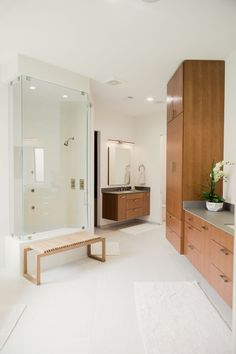 LAMBERT HOME | AUTHENTIC SPACES  You will not even believe that this is the same bathroom! This modern master bathroom has a modern freestanding bathtub, neolith wall, glass shower walls, teak wood bench by Design Within Reach and chrome fixtures. Modern Master Bathroom, Minimalist Bathroom, Modern Bathroom Design, Funny Shower Curtains, Bathroom Shower Curtains, Freestanding Bathtub, Shower Walls, Floating Vanity, Modern Baths