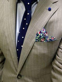 Navy Floral Pocket Square — Navy and White Polka Dot Tie — Grey Dress Shirt — Tan Vertical Striped Blazer & A Very Beautiful Navy Lapel Pin For Men. Dress Shirt And Tie, Suit And Tie, Sharp Dressed Man, Well Dressed Men, Tie And Pocket Square, Pocket Squares, Mens Fashion Blog, Men's Fashion, Spring Fashion