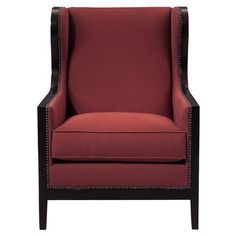 Feel like a king or queen in the royal red armchair. With a solid wood frame, the classic silhouette is bordered in a dark polished finish. The woven ruby red fabric adds rich, saturated color to any interior. A classic nail head trim, in brushed nickel, is the final finishing touch on this classically tailored arm chair.