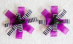 This would be the perfect accessory for any little witch this Halloween! This is our Witch hat hair bow; you can always match it to your little one's Halloween themed outfit. Each bow measures about 3 inches around. With this listing you can order 1 bow or two bows and choose the clip style.   As always all of our hair bows are handmade by me and made in a smoke free home.