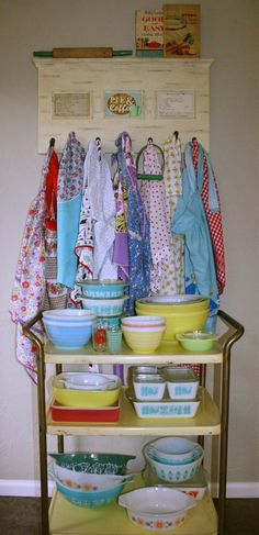 Aprons & Pyrex. i love both of these things.  though i would suggest displaying pyrex at eye level. so one can really appreciate the beauty of the bowls.