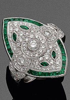 An Art Deco platinum, diamond and emerald ring. #ArtDeco #ring