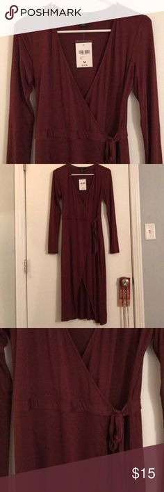 Rust Colored Dress Rust Colored Dress that ties in the front. Bought online, was the wrong size and never exchanged. NWT. Dress completely unties to put on. Deep v-neck. Can request pictures on. Forever 21 Dresses Midi