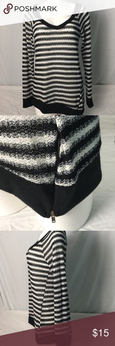 Windsor Long sleeved Sweater Windsor Long sleeved sweater with a V neck. Black and white striped with a zipper at the bottom. Cuff, hem and trim of V neck are all solid black. Loosely knitted Windsor Sweaters V-Necks
