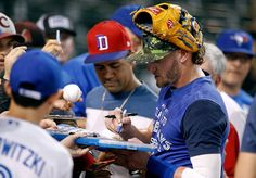 Josh Donaldson Photos - Josh Donaldson #20 of the Toronto Blue Jays signs autographs for fans before the start of a MLB interleague game against the Arizona Diamondbacks at Chase Field on July 19, 2016 in Phoenix, Arizona. - Toronto Blue Jays v Arizona Diamondbacks