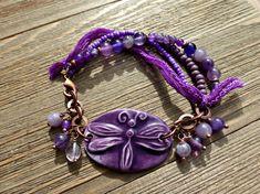 Purple ceramic dragonfly, amethyst purple stones, copper metal and silk ribbon bracelet.