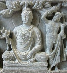 Greco-Buddhist art from Gandhara, 1st century BC. This depicts the Buddha with Heracles (in place of Vajrapani) as his protector bodhisattva. A wonderful cross-cultural masterpiece in the overlapping of Alexander's empire and the Indian empires.  One of history's few examples of Eastern-Western interaction.