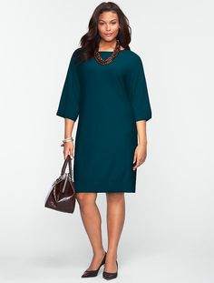 """Sweater Dress New    $159.00 A feminine pull-on with flattering dolman sleeves. Crafted in our fine Merino wool fabric. Boat neckline Dolman sleeves Length from waist: Misses 36 1/2""""; Petite 34 1/2""""; Woman 39 1/2""""; Woman Petite 38"""" (below the knee) 100% Merino wool Dry clean Imported"""